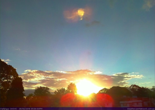 image Nibiru and its debris trail appear at sunset.